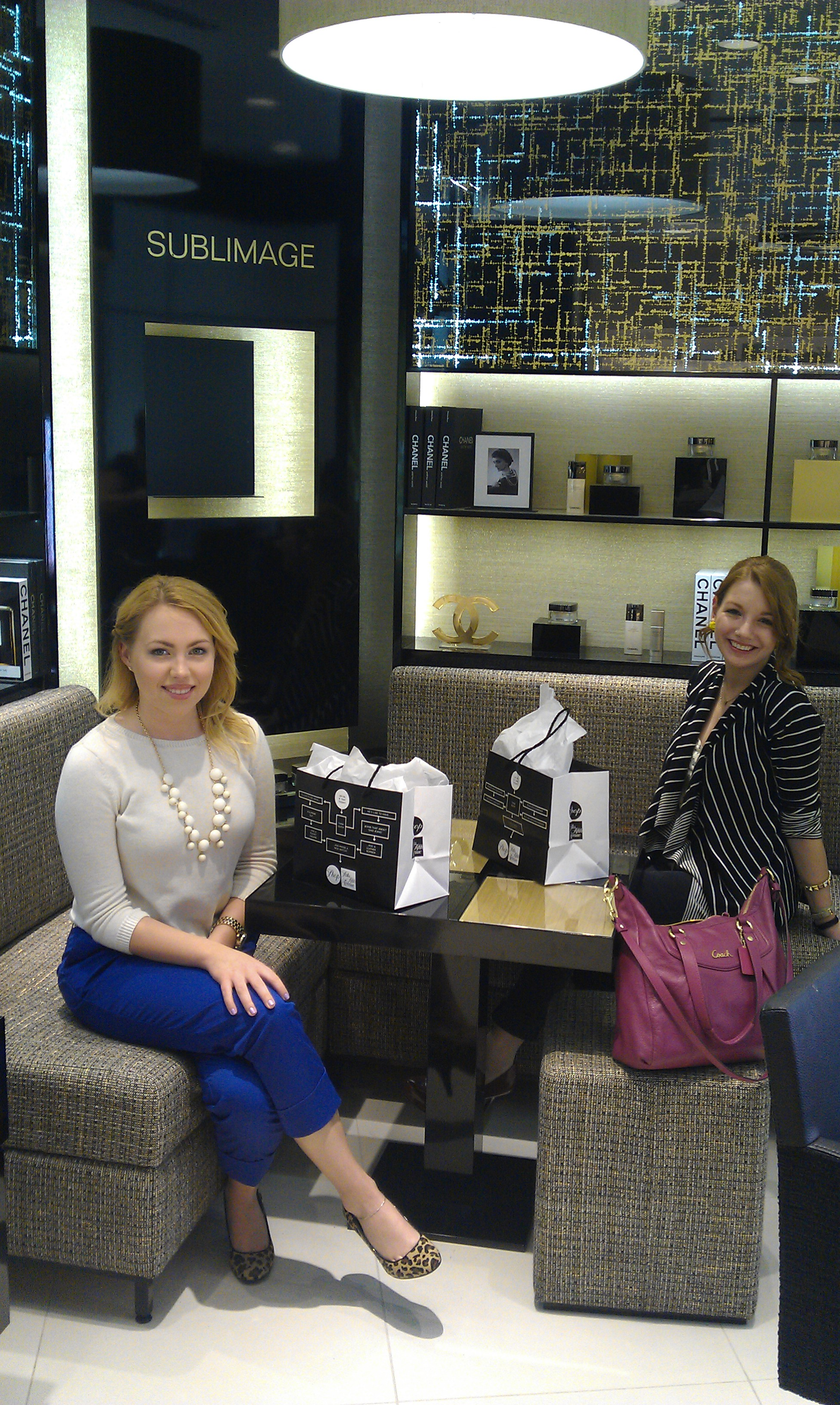 Blogger Kelsey Wolfe and I lounging in Chanel