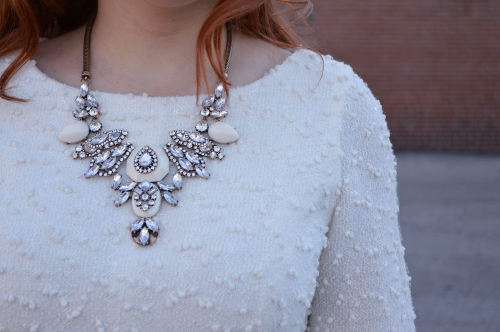 holiday-outfit-idea-from-ohjuliaann-com-winter-white-sparkly-dress-with-black-boots-tights-and-statement-necklace