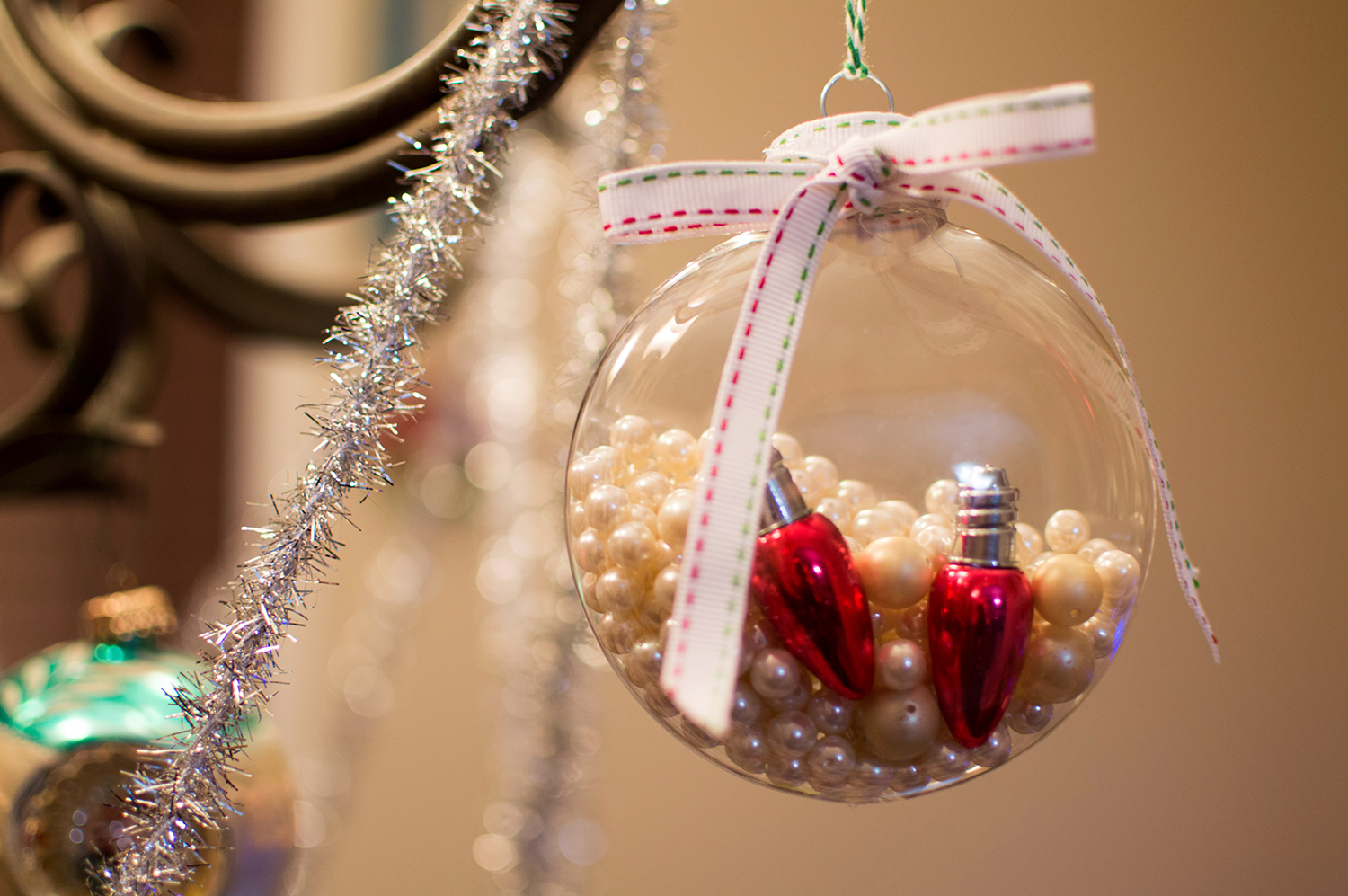 Easy diy ornaments 3 easy christmas crafts for the holiday weekend anyone else have a pile of broken jewelry you cant make yourself throw away in mine has sat a pile of old fake pearls and these broken light bulb earrings solutioingenieria Gallery